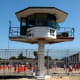 Guard tower and inmates in recreation