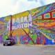 Mural at 420 Travis Street in Houston by Aerosol Warfare