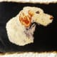 A little dog needlepoint created by my grandmother that we had remade into a pillow.