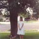 Sarah was very pleased that my wedding dress fit her and she is modeling it here in our front yard in Newbury Park.