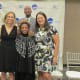 Claudette the widow of Walker pose with other recipients of the 2018 Athletics Hall of Fame awards.