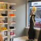 Other accessories such as shoes, handbags and scarfs are neatly displayed within Jacqueline's shop.