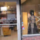 An uniquely designed outfit is displayed within Jacqueline's window downtown Chester.