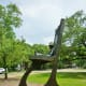 """Sculpture titled """"Retired Cowboy Clown"""" by Hans Molzberger in True South sculpture exhibit Houston"""