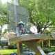 """View of """"Retired Cowboy Clown"""" sculpture by Hans Molzberger in True South sculpture exhibit Houston"""