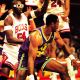 Karl Malone struggles against Chicago Bull's tight defense.