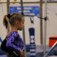 Beginning pose in Level 5 gymnastics floor routine
