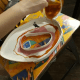 Pour the resin in a circular manner, layering the colors.