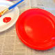 Paint a paper plate red.