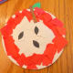 Glue on pieces of construction paper to paper plate to create apple design.