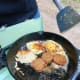 Fried eggs and sausage make for a great outdoor breakfast.