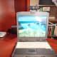 eMeet Nova perching atop a laptop