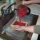 Step 4: Pour the pulp into the deckle.