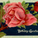 """vintage birthday card: red and pink roses on a black background """"Birthday Greetings"""""""