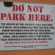A very eloquent no parking sign.