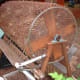 A homemade compost tumbler. You can quickly and easily build one of these yourself and use it for a long time before you have to build another one.