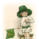 Little vintage boy in green top hat with Irish flag