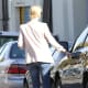 Charlize Theron seen getting in her car  in a stylish jeans and jacket look