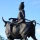 Shiva is riding on Nandi, his bull. Shiva is one of the triumvirate of principal Hindu Gods