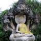This Buddha image in one of the many gardens in the park is being protected by the Naga, a giant snake in Buddhist mythology, often depicted with multiple heads