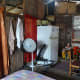 The interiors of the house. The two curtains separate the bedroom and kitchen. The red curtain is the kitchen entrance.