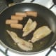 Turkey meat is briefly fried and reheated with sausages