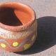 An ice cream pot made of clay in India.