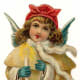 Vintage Christmas angel dressed in ivory coat with candle