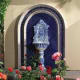 Reminiscent of an old European pedestal fountain, this example is set into an arched blue-and-white tiled surround.