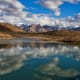 A beautiful reflection of puffy clouds in the Dhankar Lake, located at an altitude of about 14000 feet in Spiti Valley, Himachal Pradesh.