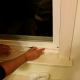Applying double-sided adhesive tape to the bottom of the window