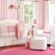 striped pink wallpaper in babies nursery