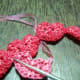 WIP 2 - Pass the plarn underneath the previous heart chain.