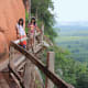 Climbing the hill is just a little hair-raising for those with a touch of vertigo This rickety wooden bridge is the route to the top