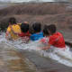 Children enjoying a natural water chute