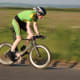 A rider aboard a Planet X Exocet Time Trial Bike in a panning photography shot