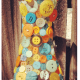 Colorful buttons on vase