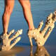 Sand castles and hairy legs. Just unusual beach attire
