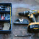 Tools for fitting, a spirit level, screwdriver and drill and wall plugs