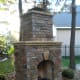 outdoor fire place more formal in design with symmetrical square stones