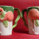Two flamingo themed cups.