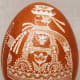 Shepherd motif on scratchwork or etched egg.