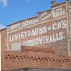 A Levi Strauss advertising sign painted on a brick wall in Woodland, California