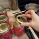 Step Six: Wipe the rims of your jars with a wet washcloth and add lids and rings.