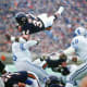 One of the greatest players in NFL history, Walter Payton earned nine Pro Bowl selections and set several rushing records during his 13 years with the Chicago Bears.