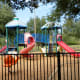 Gated Tot Lot play area in Ray Miller Park