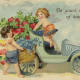 Two cherubs with a car full of hearts vintage Valentine card