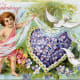 Cherub and dove with a heart made of flowers vintage Valentine's Day greeting card