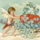 Two cherubs with a flower cart vintage Valentine card