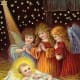 Three vintage angels with baby Jesus in the manger